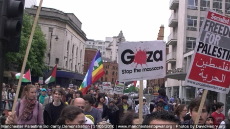 Thousands of people marched through Manchester, approaching St Peter's Square and the Peace Gardens